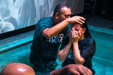 Pastor Carlos praying over Juliana